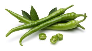 Green chillies isolated on white background.